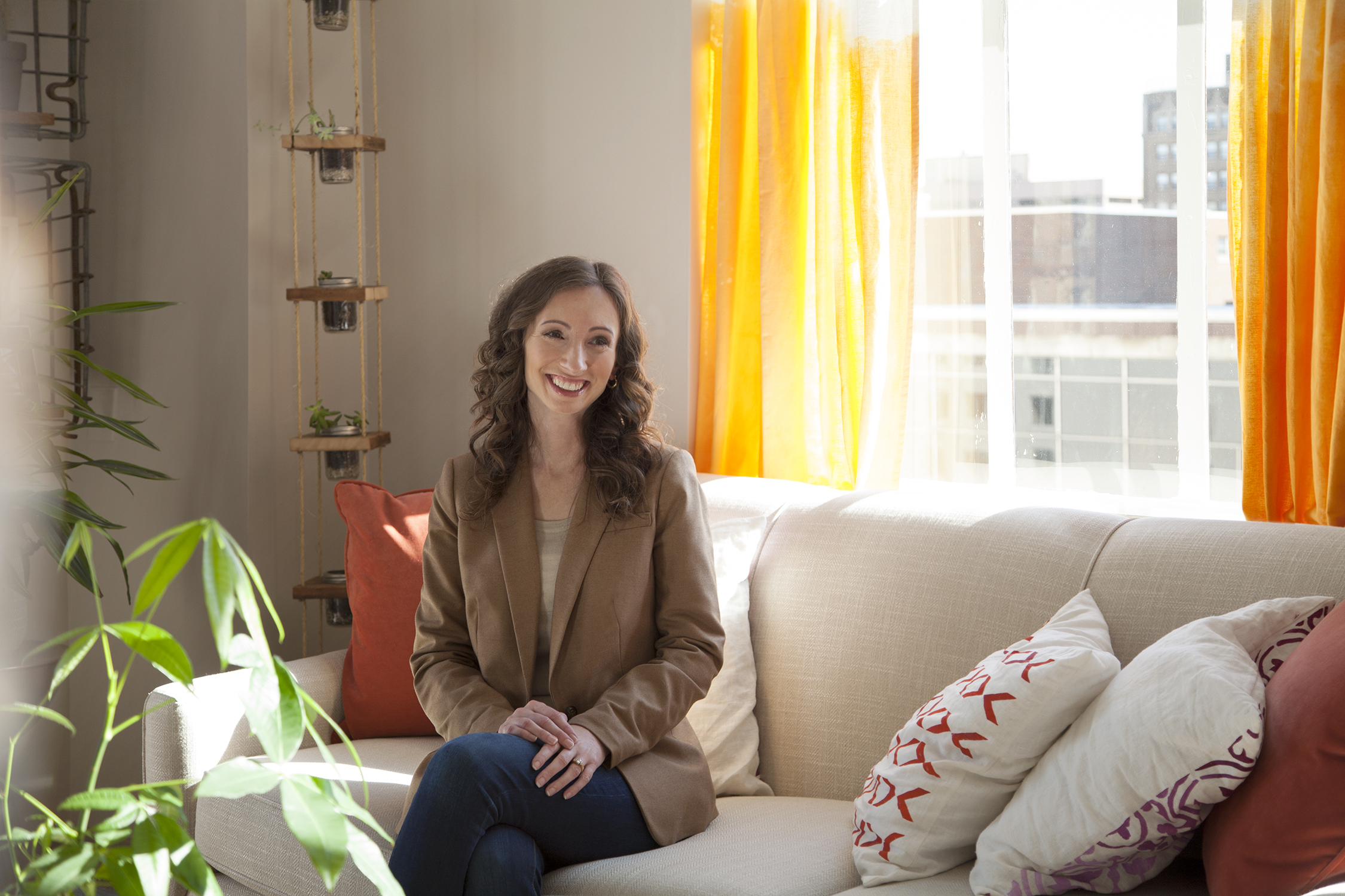 woman on couch, bright office, Sarah Tomes, executive office